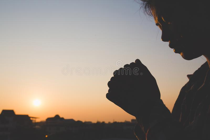 Young woman praying with hand, prayer concept for faith, spirituality and religion royalty free stock photos
