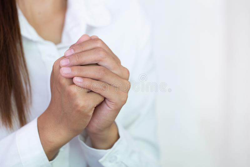 Young woman praying with  hand,  prayer concept for faith, spirituality and religion stock photo