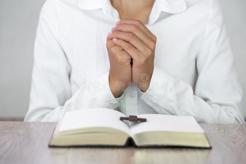 Young woman praying with  hand,  prayer concept for faith, spirituality and religion royalty free stock image