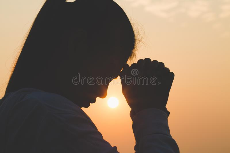 Young woman praying in the morning, Hands folded in prayer concept for faith, spirituality and religion.  royalty free stock photography