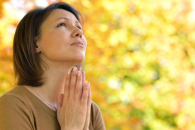 Young woman praying royalty free stock photos
