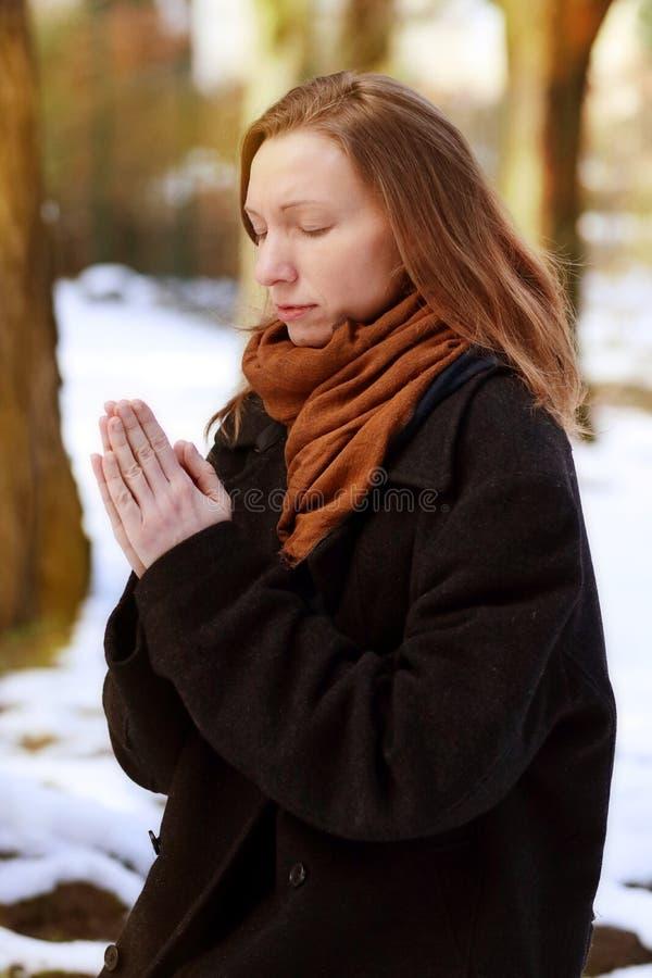 Prayer Woman praying in winter. faith religion spirituality royalty free stock photo