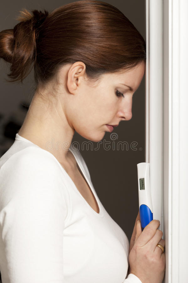 Young woman with pregnancy test royalty free stock image