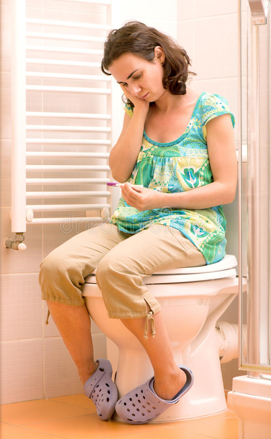 Young woman with pregnancy test stock image