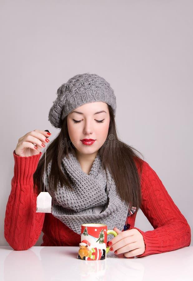 Young woman prepares tea royalty free stock photo