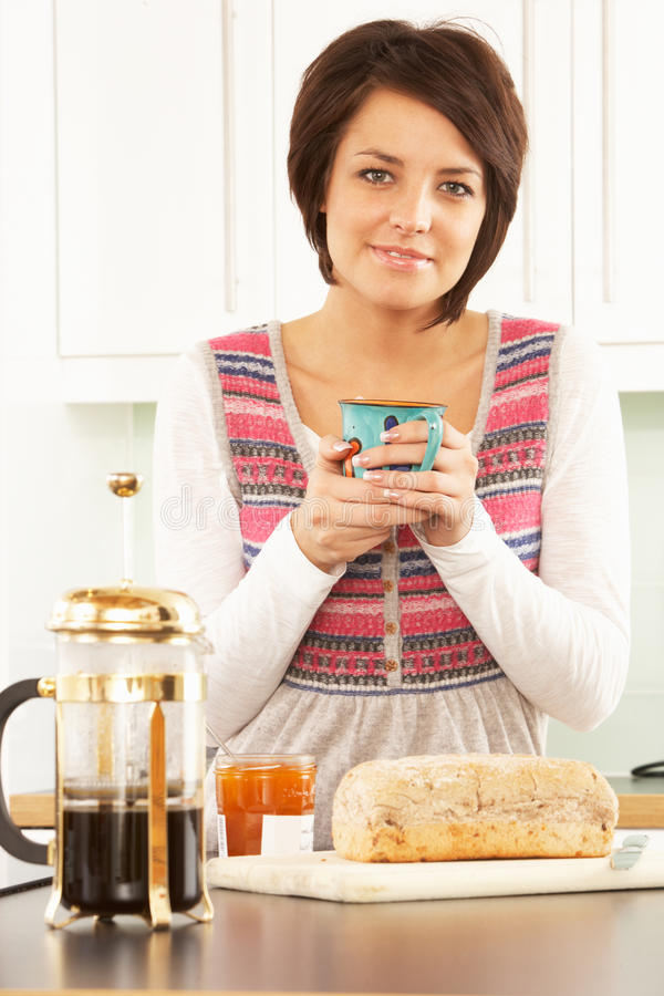 Download Young Woman Preparing Breakfast In Kitchen Stock Image - Image of cute, people: 14720139