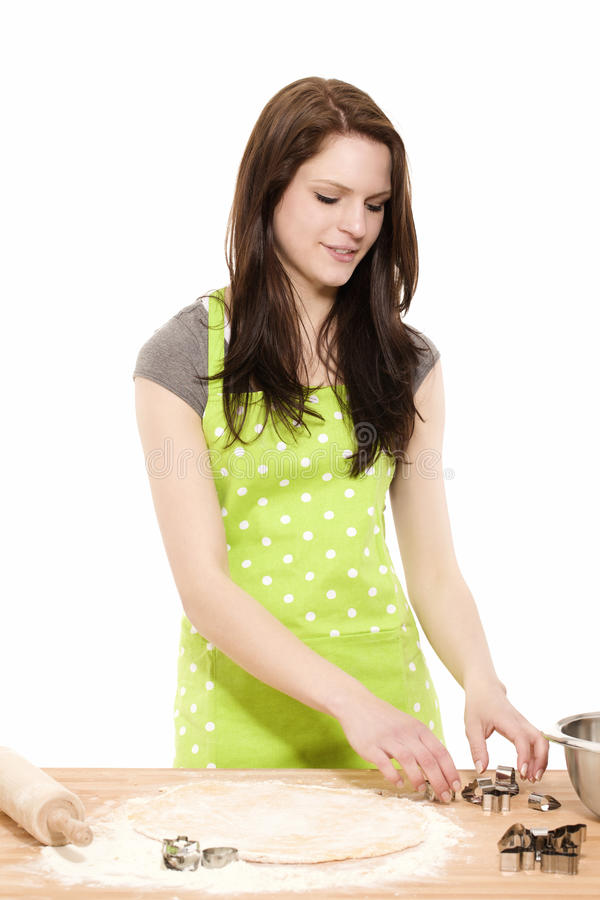 Young woman preparing christmas molds royalty free stock images