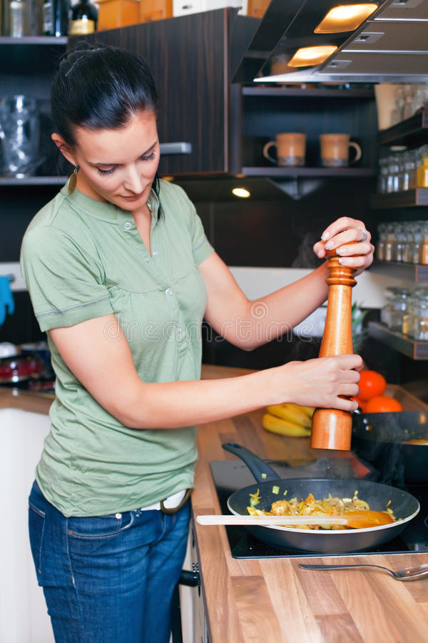 Download Young Woman Preparing Lunch Stock Photo - Image: 18311236