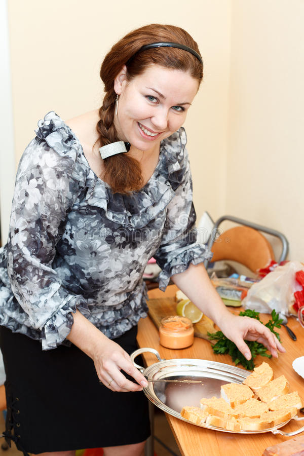 Download Young Woman Preparing Sandwiches Royalty Free Stock Photography - Image: 21916577