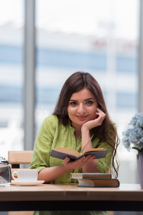 The young woman preparing for school exams stock image