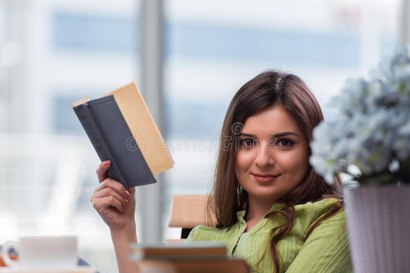The young woman preparing for school exams stock photos