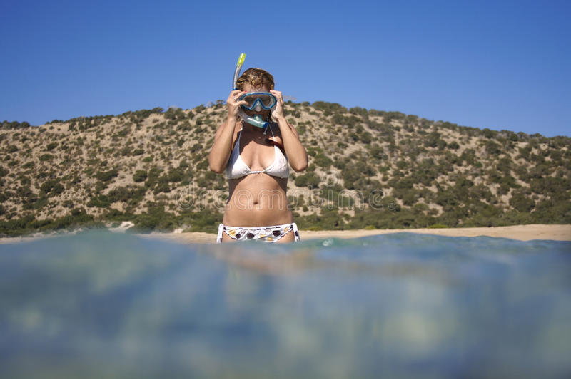 Young woman preparing for snorkeling. royalty free stock photos