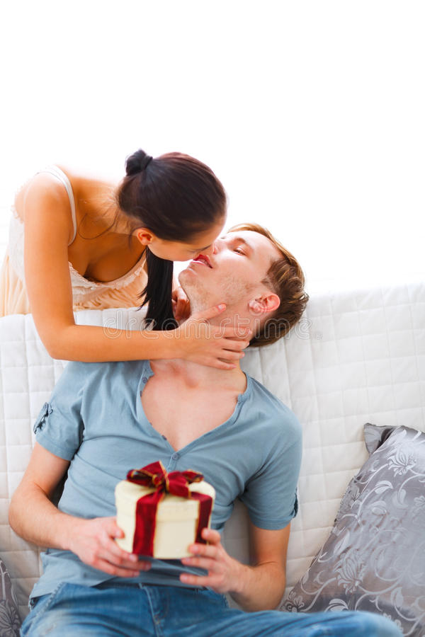 Young Woman Present Gift To Her Husband Royalty Free Stock Image