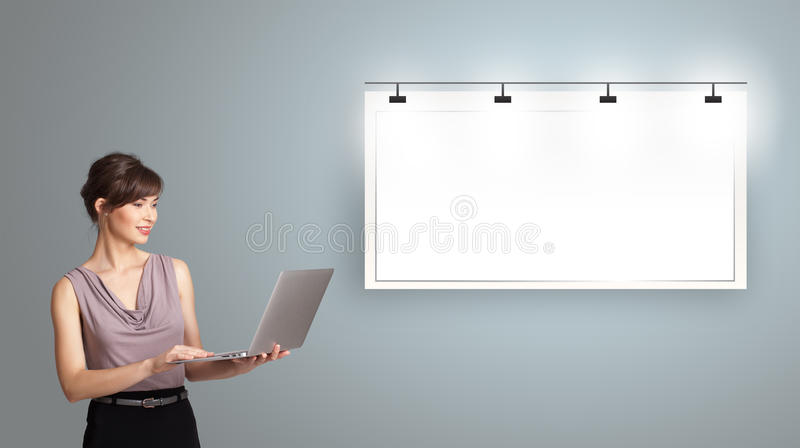 Download Young Woman Presenting Modern Copy Space Stock Image - Image: 27884449