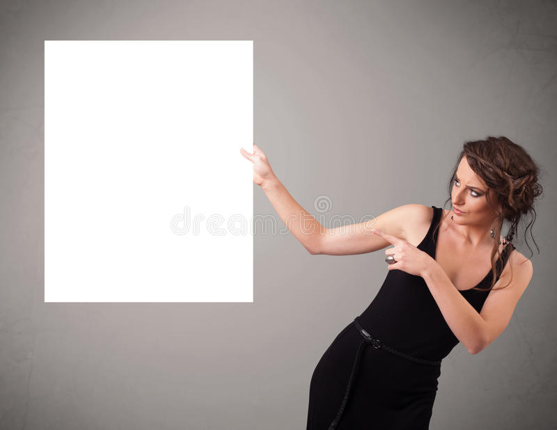 Download Young Woman Presenting White Paper Copy Space Stock Photo - Image: 32069972