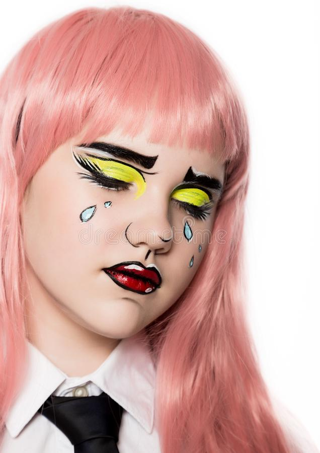 Young woman with professional comic pop art make-up. Funny cartoon or comic strip make-up royalty free stock photography