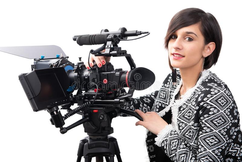 Young woman with professional video camera, SLR, on white stock photography