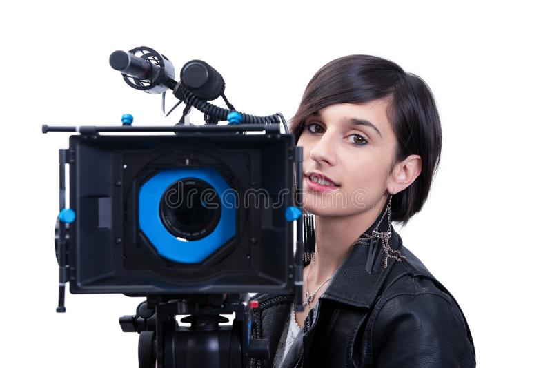 Young woman with professional video camera, SLR, on white royalty free stock images