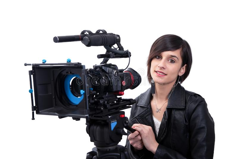 Young woman with professional video camera, SLR, on white stock image