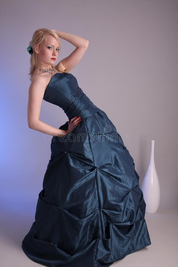 Young woman with prom dress. Beautiful young woman wearing a blue prom dress stock photo