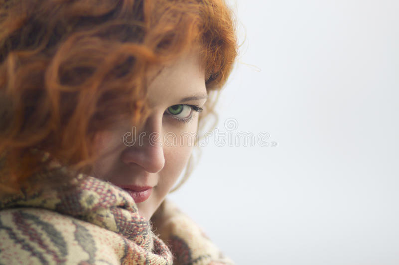 Young Woman Protects Her From The Cold Royalty Free Stock Photos
