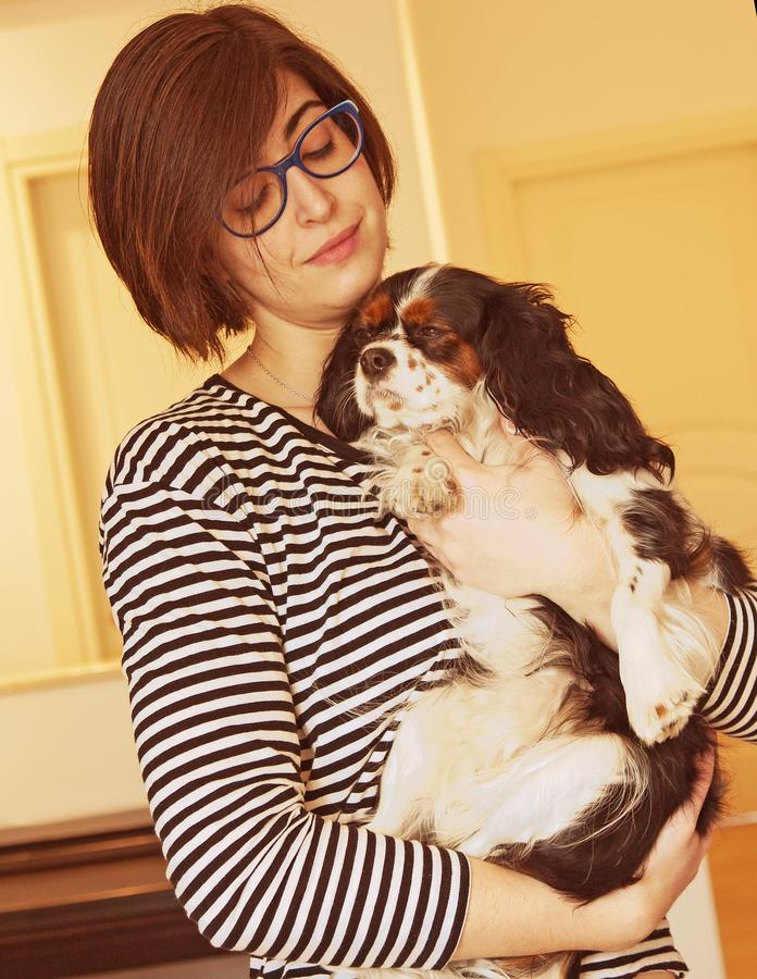 Young woman with puppy stock photography