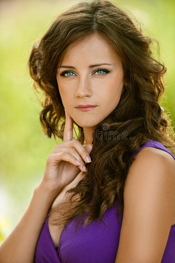 Young Woman In Purple Dress Thought Royalty Free Stock Photos