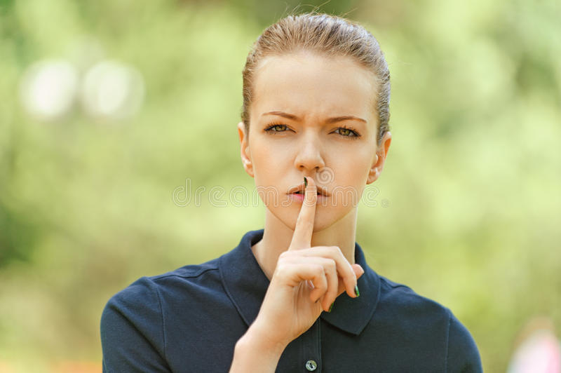 Download Young Woman Put Finger To Lips Royalty Free Stock Images - Image: 27662759