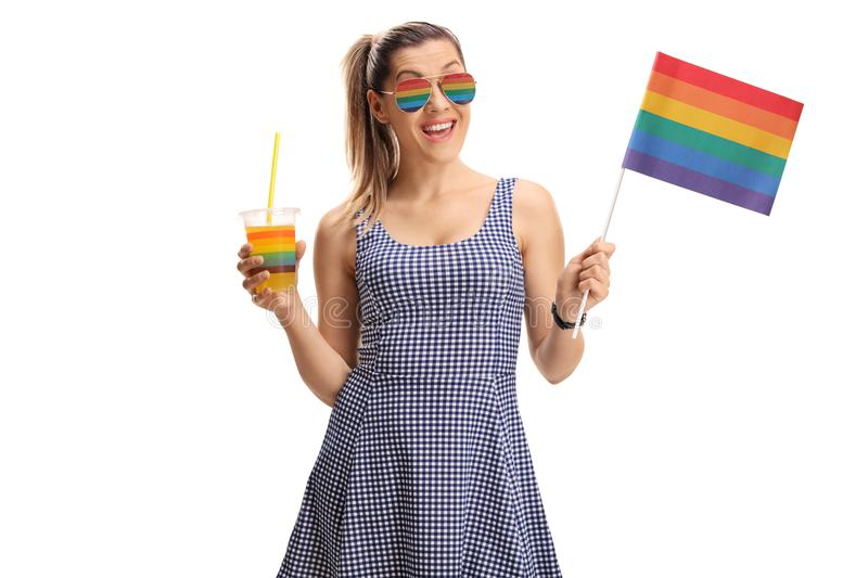 Young woman with a rainbow flag stock photos