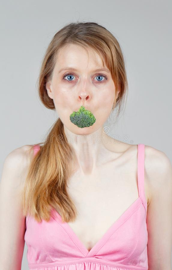Broccoli inside mouth royalty free stock photography