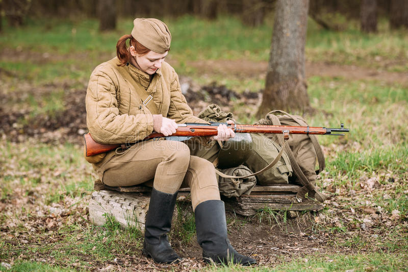Young Woman Re-enactor Dressed As Russian Soviet Infantry Soldier Of World War II. Pribor, Belarus - April 23, 2016: Young Woman Re-enactor Dressed As Russian royalty free stock photos