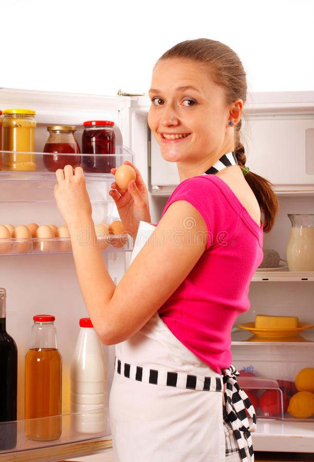 Young Woman Reaching For Eggs Stock Image