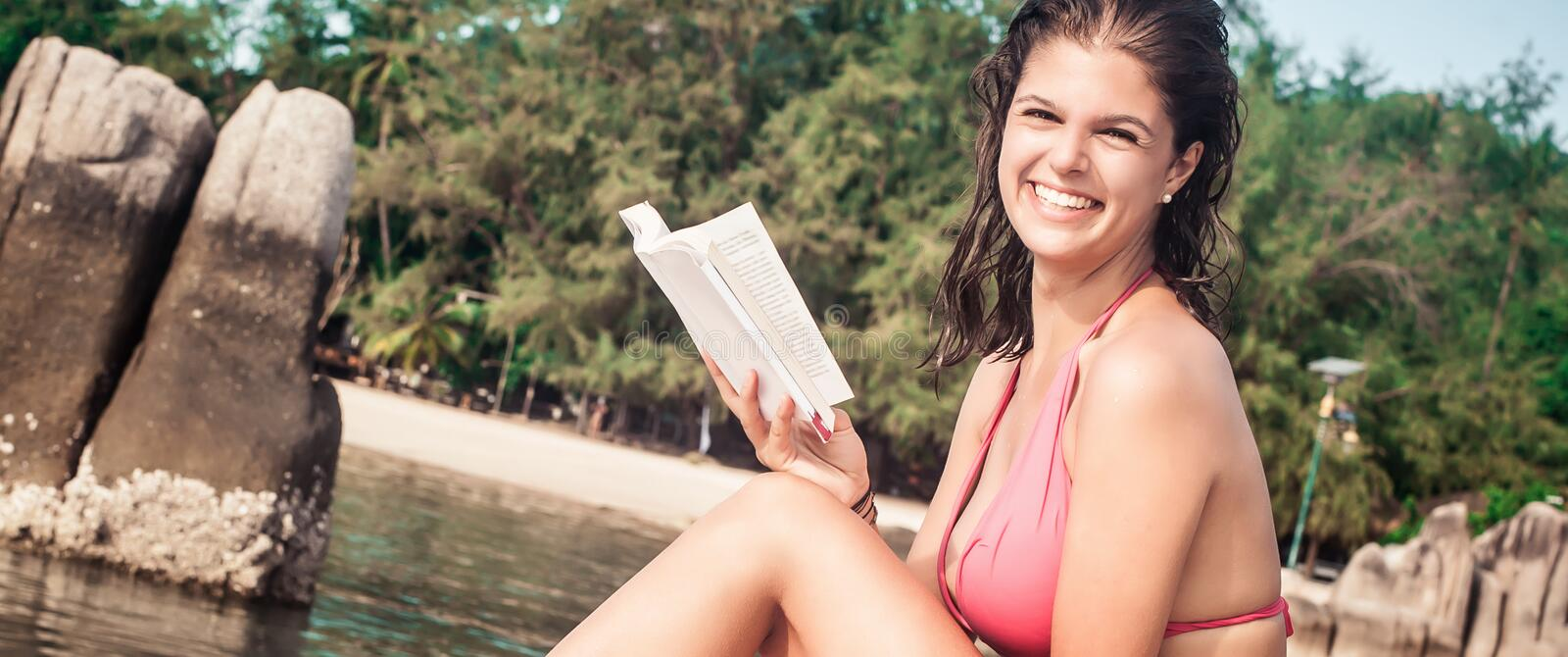 Young woman read book during beach vacation stock image