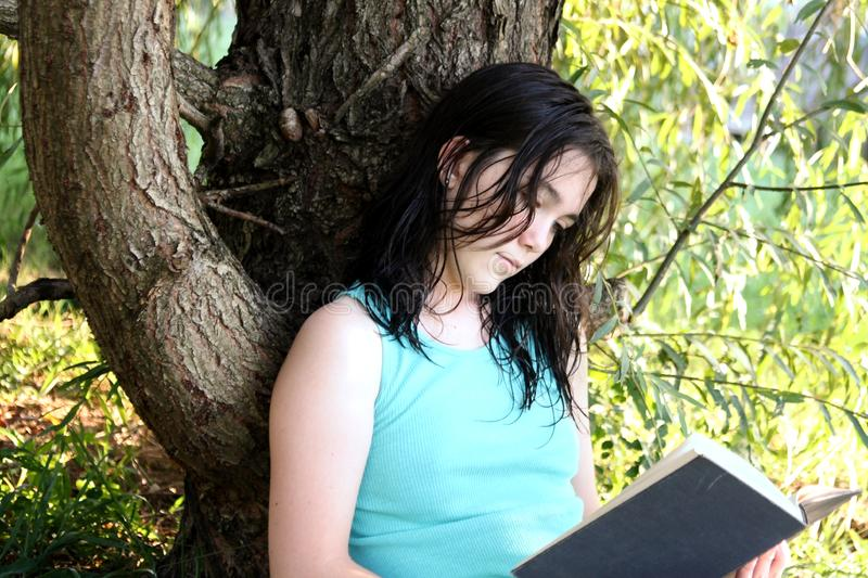 young woman reading royalty free stock images