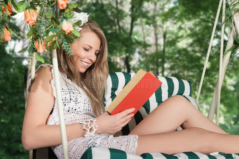 Download Young woman reading a book stock image. Image of outdoor - 25524171
