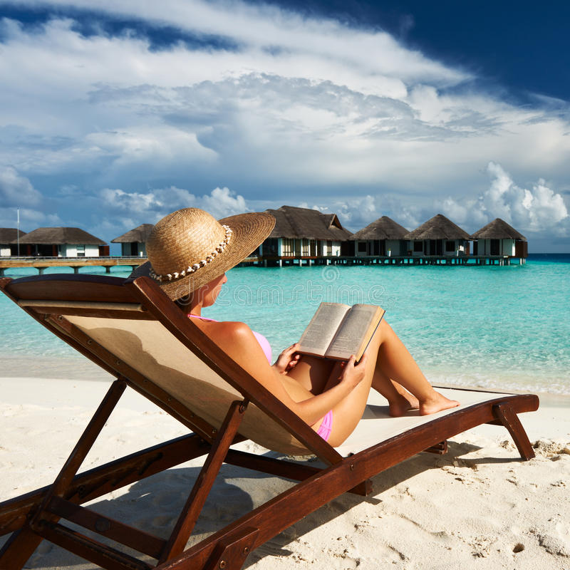 Download Young Woman Reading A Book At Beach Stock Image - Image: 29504791