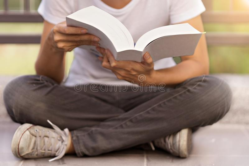 Young woman reading a book at home. In concept education or business royalty free stock image