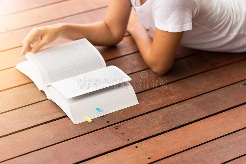 Young woman reading a book at home. Education or business concept royalty free stock images