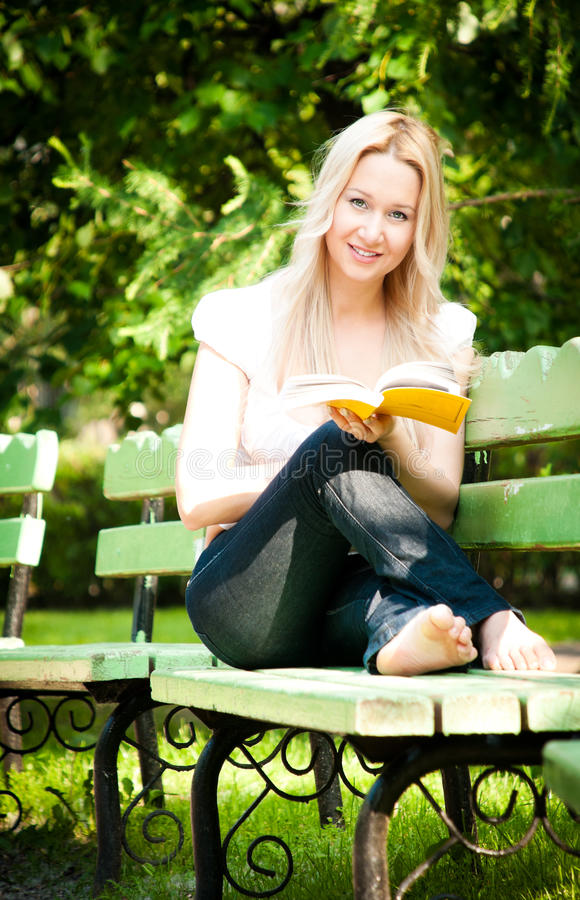 Download Young Woman Reading Book In Park Stock Image - Image of outdoor, caucasian: 14853111