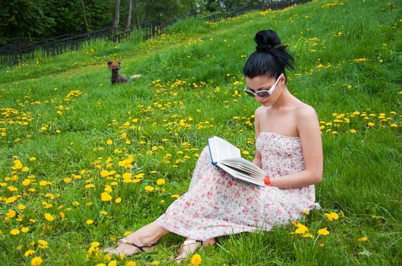 Download Young Woman Reading A Book In The Park Stock Photo - Image: 19689584