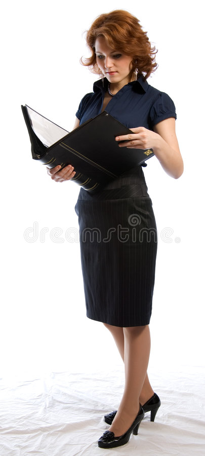 The young woman reading the documents stock photo