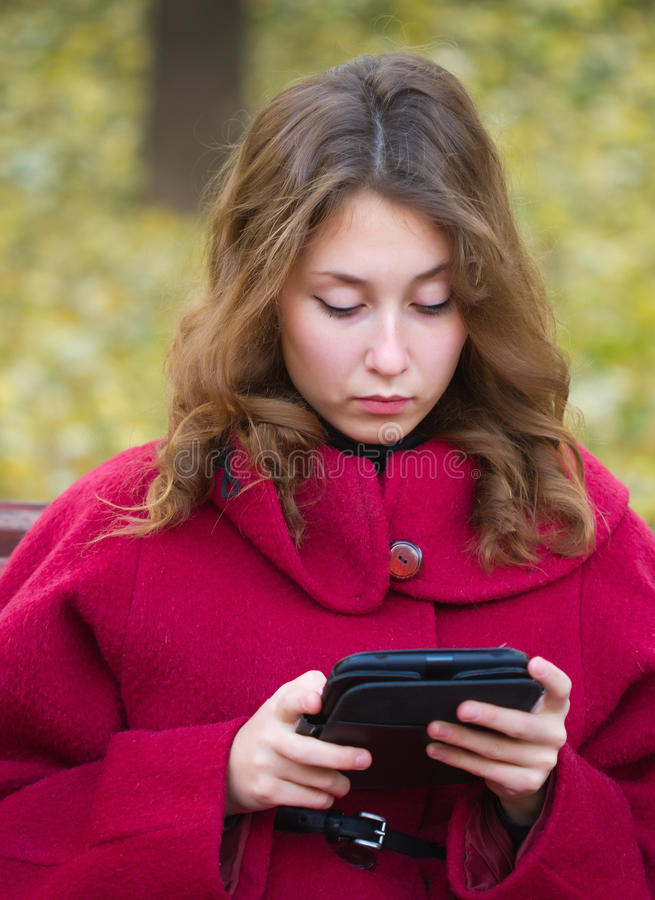 Young woman reading ebook