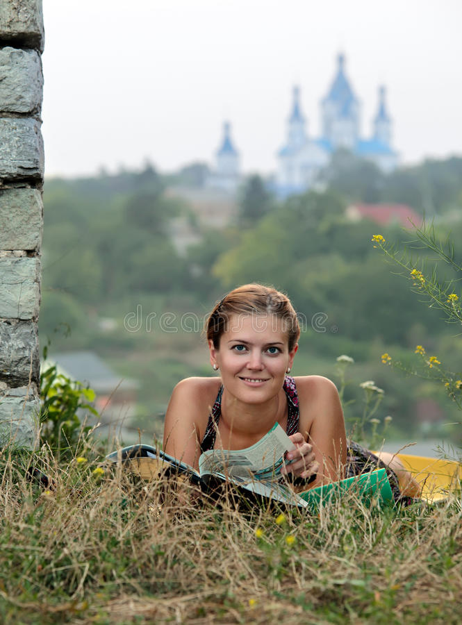 Download Young Woman Reading Magazine Lying On Grass Royalty Free Stock Photos - Image: 19305008