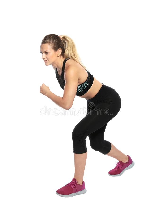 Young woman ready to run. On white background royalty free stock photos