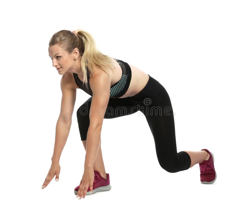 Young woman ready to run. On white background royalty free stock photography
