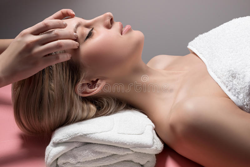 Young woman receiving facial massage royalty free stock photo