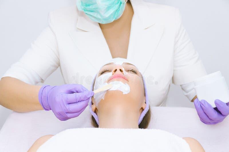 Young woman receiving facial treatment stock image
