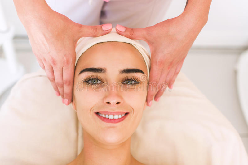 Young woman receiving a head massage. royalty free stock photo