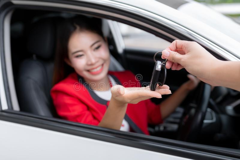 Young woman receiving the keys of her new car, Photo of happy yo stock photos