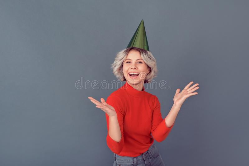 Young woman in a red blouse on grey wall party stock images